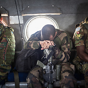 Peacekeepers in helicopter <br /> flying over implementation of Ugandan rebel area.