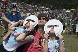 August 21, 2017 - Woodstock, Georgia, U.S. - Crowd of hundreds gather in north Georgia town center for a 'Solar Eclipse Party.' (Credit Image: © Robin Rayne Nelson via ZUMA Wire)