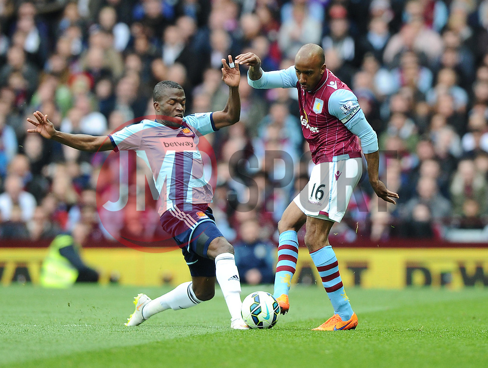 Aston Villa's Fabian Delph  battles for the ball with West Ham United's Enner Valencia - Photo mandatory by-line: Joe Meredith/JMP - Mobile: 07966 386802 - 09/05/2015 - SPORT - Football - Birmingham - Villa Park - Aston Villa v West Ham United - Barclays Premier League