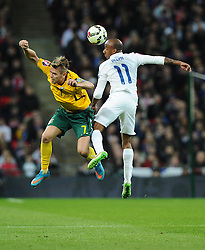 Fabian Delph of England (Aston Villa) battles for the high ball with Arturas Zulpa of Lithuania  - Photo mandatory by-line: Joe Meredith/JMP - Mobile: 07966 386802 - 27/03/2015 - SPORT - Football - London - Wembley Stadium - England v Lithuania - UEFA EURO 2016 Qualifier