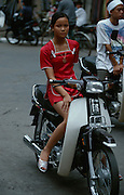 Young girl on a motorbike.