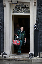 © Licensed to London News Pictures. 15/05/2017. London, UK. A paramedic leaves 10 Downing Street after a worker was injured inside. A COBRA meeting is being held later as members of British government are meeting to discuss the recent cyber attack on over 150 countries, which crippled parts of the NHS.  Photo credit: Peter Macdiarmid/LNP
