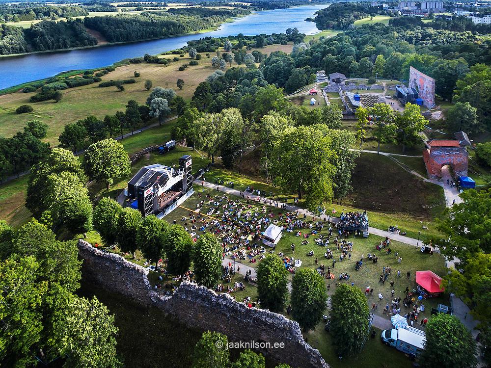 Folk music festival in Viljandi bishop castle, Estonia. Aerial view, lake, ruins and walls. Public, open-air stage.