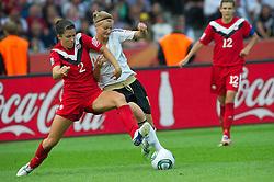 26-06-2011 VOETBAL: FIFA WOMENS WORLDCUP 2011 GERMANY - CANADA: BERLIN<br /> Zweikampf 2 Emily ZURRER Alexnadra Popp (GER11 #11, Duisburg) re 12 Christine SINCLAIR<br /> ***NETHERLANDS ONLY***<br /> ©2011-FRH- NPH/Kokenge