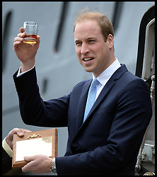The Duke of Cambridge Prince William, The Commodore-in-Chief Submarines, has a glass of rum during a visit to The Royal Navy Submarine Museum in Gosport, Hampshire, United Kingdom. Monday, 12th May 2014. Picture by Andrew Parsons / i-Images