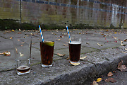 Three glasses, one empty and two almost full, have been left in the street, the morning after New Year's Eve, on 1st January 2019, in south London, England.