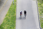 In Nijmegen rijden twee racefietsers over de gewone rijbaan in plaats van het verplichte fietspad.<br /> <br /> In Nijmegen two men on  racing bikes cycle on the road instead of the obligatory bike lane.