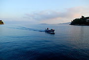 Fishing boat returning to harbour at dawn, Racisce, island of Korcula, Croatia