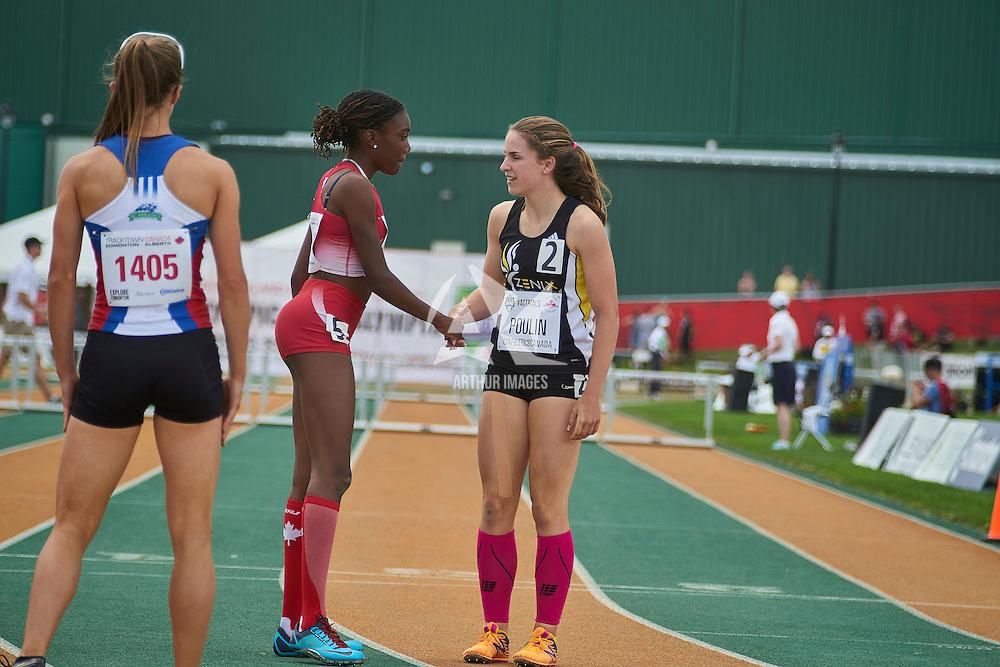 Santiago congratulates her competitors following the 400m hurdles.