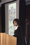"With a slide showing the TV promo for the upcoming PBS program ""African American Lives2"" behind her, Kathleen Henderson speaks to those gathered for a special preview of the show at the University of Dayton's Kennedy Union Ballroom, Wednesday, January 23, 2008."