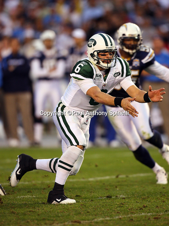 New York Jets quarterback Mark Sanchez (6) pitches the ball on a running play during the AFC Divisional Playoff game against the San Diego Chargers, January 17, 2010 in San Diego, California. The Jets won the game 17-14. ©Paul Anthony Spinelli