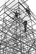 Crew climbing the scaffolding, Glastonbury, Somerset, 1989
