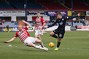 4th May 2019, Dens Park, Dundee, Scotland; Ladbrokes Premiership football, Dundee versus Hamilton Academical; Andrew Nelson of Dundee is tackled by Ziggy Gordon of Hamilton Academical