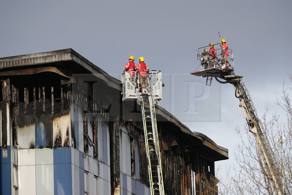 "© Licensed to London News Pictures. 16/11/2019. Bolton, UK. Firefighters work at the scene where a fire broke out overnight (15th/16th November 2019) at a block of flats known as "" The Cube "" , in Bolton Town Centre . At least two people are known to have been treated by paramedics at the scene of the six-story , block which is occupied by students of the University of Bolton . Photo credit: Joel Goodman/LNP"
