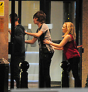 30.OCTOBER.2011 LONDON<br /> <br /> **&pound;250 MINIMUM PER USAGE** <br /> <br /> FRANKIE COCOZZA AND AMELIA LILY LEAVING FOUNTAIN STUDIOS IN WEMBLEY WITH A GROUP OF OTHER PEOPLE AFTER THE X-FACTOR RESULTS SHOW, THEY HEADED TO AN OFF LICENCE TO BUY SOME ALCOHOL THEY THEN HEADED TO A HOTEL WITH A GROUP OF GIRLS AND CHARLIE AND MARCUS, AT 1.15AM FRANKIE AND AMELIA WENT FOR A LITTLE WALK IN THE UNDERGROUND CAR PARK AND RE-EMERGED AT 2.00AM AND WENT BACK INTO THE HOTEL, THEN AT 3.00AM FRANKIE CAME OUTSIDE AGAIN THIS TIME WITH A MYSTERY BLONDE IN THE RED TOP AND THEY HEADED DOWN TO THE UNDERGROUND CAR PARK WHERE THE GIRL FELL OVER ON THE WAY DOWN, THEY THEN RE-EMERGED AT 3.30AM AND WENT BACK INTO THE HOTEL THEN AT 4.00AM AMELIA CAME STORMING OUT THE HOTEL ON HER PHONE CRYING AND SAT ON THE CURB SAYING &quot;I CAN'T BELEIVE WHAT HE DONE&quot; THEN AT 4.30AM HER FRIEND CAME AND PICKED HER UP IN THE WHITE BETTLE.<br /> <br /> BYLINE: EDBIMAGEARCHIVE.COM<br /> <br /> *THIS IMAGE IS STRICTLY FOR UK NEWSPAPERS AND MAGAZINES ONLY*<br /> *FOR WORLD WIDE SALES AND WEB USE PLEASE CONTACT EDBIMAGEARCHIVE - 0208 954 5968*