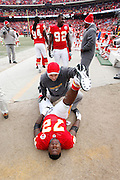Glenn Dorsey (72) of the Kansas City Chiefs is stretched out by a trainer prior to playing against the Baltimore Ravens during the AFC Wild Card Playoff game at Arrowhead Stadium on Jan. 9, 2011 in Kansas City, MO.