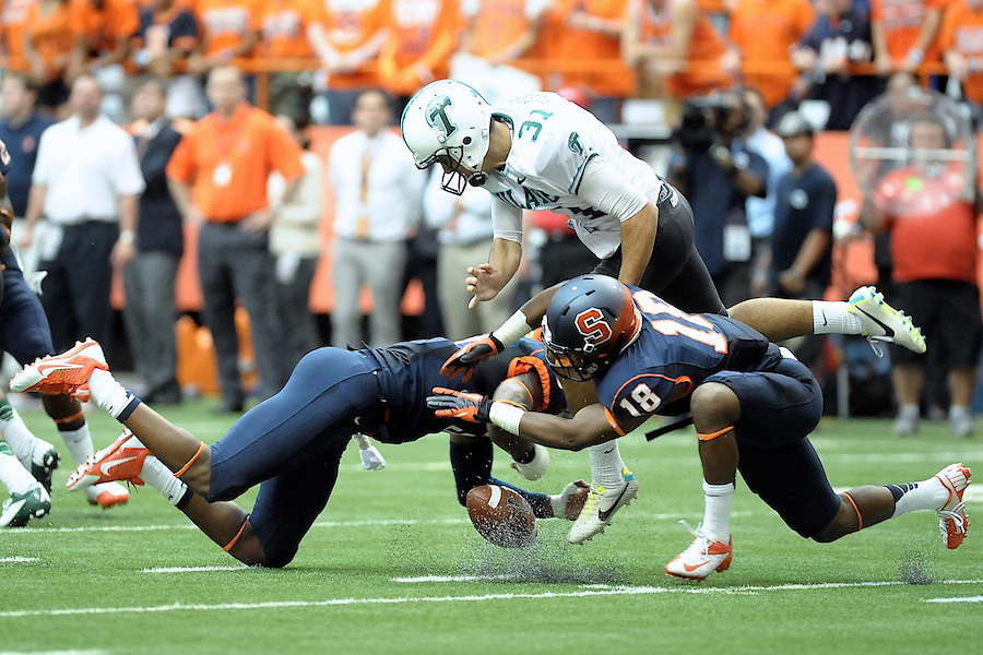 Syracuse Orange safety DURELL ESKRIDGE (3) and Syracuse Orange defensive back DARIUS KELLY (18)  block the punt by Tulane Green Wave punter PETER PICERELLI (31) during the first quarter at the Carrier Dome in Syracuse, NY. Syracuse leads Tulane 42-17 at the half.
