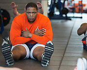 Jay Bromley, a defensive tackle for the Syracuse University football team, does an abdominal exercise during a workout in Syracuse, New York on Friday, May 2, 2014. Bromley, who attended Flushing High School, is projected as a late-round NFL draft pick.