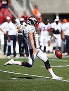 Denver Broncos punter Britton Colquitt (4) punts during the 2014 NFL preseason football game against the San Francisco 49ers on Sunday, Aug. 17, 2014 in Santa Clara, Calif. The Broncos won the game in a 34-0 shutout. ©Paul Anthony Spinelli