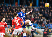 Gillingham forward Rory Donnelly gets to the ball ahead of Swindon defender Jordan Turnbull during the Sky Bet League 1 match between Gillingham and Swindon Town at the MEMS Priestfield Stadium, Gillingham, England on 6 February 2016. Photo by David Charbit.