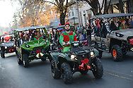 Vincent Adams of Newtown, Pennsylvania rides a 4 wheel vehicle dressed as an elf during the Newtown Holiday Parade Sunday December 6, 2015 in Newtown, Pennsylvania. (Photo by William Thomas Cain)