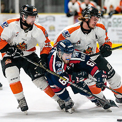 COCHRANE, ON - MAY 2: Hunter Buzzi #61 of the Cochrane Crunch battles Jake Desando #16 of the Hearst Lumberjacks & J.J. Berdal #25 of the Hearst Lumberjacks for possession on May 2, 2019 at Tim Horton Events Centre in Cochrane, Ontario, Canada.<br /> (Photo by Christian Bender / OJHL Images)