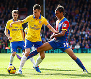 Picture by David Horn/Focus Images Ltd +44 7545 970036<br /> 26/10/2013<br /> Marouane Chamakh of Crystal Palace (right) tackles Laurent Koscielny of Arsenal (left) during the Barclays Premier League match at Selhurst Park, London.