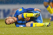 Gillingham midfielder Dean Parrett (8) writhes in pain after a foul during the EFL Sky Bet League 1 match between Gillingham and Wycombe Wanderers at the MEMS Priestfield Stadium, Gillingham, England on 15 December 2018.
