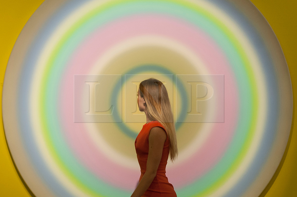 """© Licensed to London News Pictures. 08/09/2017. London, UK. A staff member views """"dreizehnterseptemberzweitausendundnull"""", 2000, by Ugo Rondinone (Est. GBP100-150k) at a preview of 'Shake It Up', a collection of contemporary artworks from the personal collection of celebrity photographer Mario Testino. Proceeds from the upcoming auction of the collection at Sotheby's in London will benefit Museo Mate in Lima, Peru.  Photo credit : Stephen Chung/LNP"""