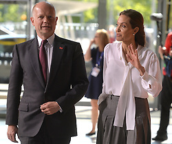 Image ©Licensed to i-Images Picture Agency. 11/06/2014.<br /> <br /> Angelina Jolie and William Hague arrive for day 2 of the Global Summit to End Sexual Violence in Conflict at The ExCel, London, UK.<br /> <br /> Wednesday 11th June 2014<br /> Picture by Ben Stevens / i-Images