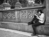 Young woman reading at Bethesda Terrace