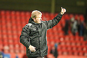 Forest Green Rovers manager Ady Pennock salutes the fans at the end of the match during the Vanarama National League match between Cheltenham Town and Forest Green Rovers at Whaddon Road, Cheltenham, England on 21 November 2015. Photo by Shane Healey.
