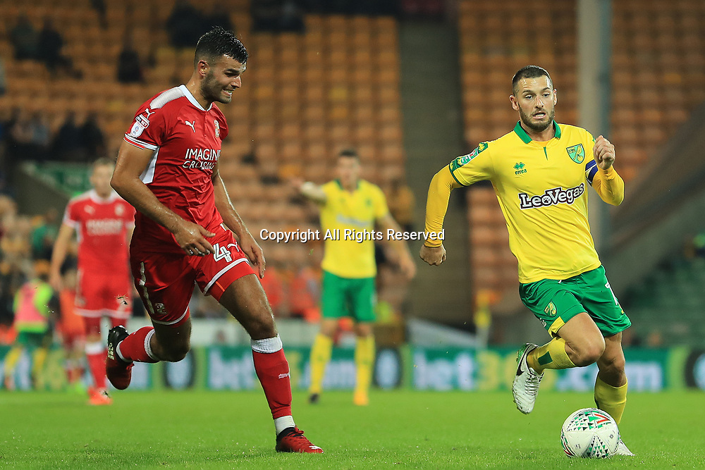 August 8th 2017, Carrow Road, Norwich, England; Carabao Cup First Round; Norwich City versus Swindon Town; Wesley Hoolahan of Norwich City is under pressure from Conor Thomas of Swindon Town
