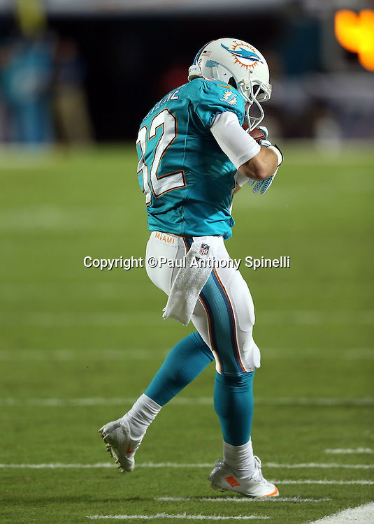 Miami Dolphins wide receiver Brian Hartline (82) catches a pass as he toe taps before going out of bounds in the second quarter during the NFL week 9 football game against the Cincinnati Bengals on Thursday, Oct. 31, 2013 in Miami Gardens, Fla.. The Dolphins won the game 22-20 in overtime. ©Paul Anthony Spinelli