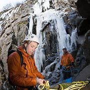 """Freyr Ingi Björnsson, Viðar Helgasson below the ice climb """"Álið er málið"""" WI4  at Þórólfsárgili, Fljótshlíð."""