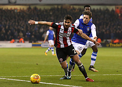 George Baldock of Sheffield United goes past Adam Reach of Sheffield Wednesday - Mandatory by-line: Robbie Stephenson/JMP - 12/01/2018 - FOOTBALL - Bramall Lane - Sheffield, England - Sheffield United v Sheffield Wednesday - Sky Bet Championship
