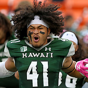 American Samoa's Scheyenne Sanitoa (Samoana HS graduate) joins his University of Hawaii Rainbow Warriors teammates in a pregame Ha'a.  San Diego State University defeated the University of Hawaii Rainbow Warriors 28-7, at Aloha Stadium, Honolulu, Hawaii in a Mountain West Conference football game. Photo by Barry Markowitz, 10/28/17, 6:10pm