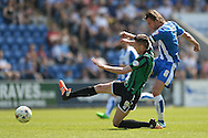 Alex Gilbey of Colchester United has a shot at goal while under pressure from Matthew Lund of Rochdale during the Sky Bet League 1 match between Colchester United and Rochdale at the Weston Homes Community Stadium, Colchester<br /> Picture by Richard Blaxall/Focus Images Ltd +44 7853 364624<br /> 08/05/2016