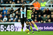 Adam Smith (#15) of AFC Bournemouth challenges Jetro Willems (#15) of Newcastle United during the Premier League match between Newcastle United and Bournemouth at St. James's Park, Newcastle, England on 9 November 2019.