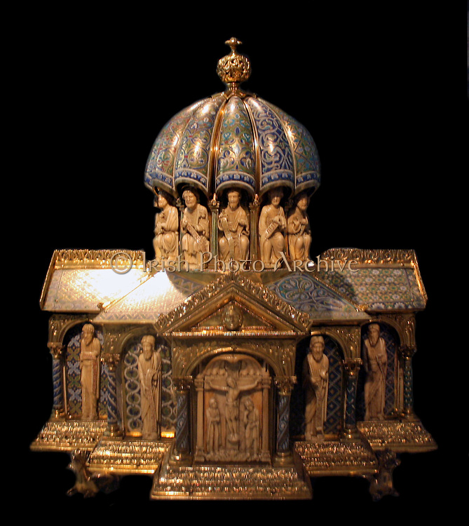 Tabernacle circa 1180. This Romanesque goldsmiths' work and carving combines widely varied foliage patterns with figures that are classically inspired.  Its function has been much debated.  The iconography, or subject matter centre's Christ's redemption of mankind, fulfilling Old Testament prophecy.  This indicates that the tabernacle probably housed the consecrated bread for the Mass.