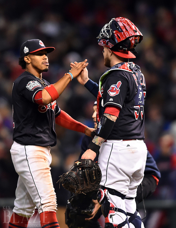 Oct 25, 2016; Cleveland, OH, USA; Cleveland Indians shortstop Francisco Lindor (left) celebrates with catcher Roberto Perez (55) after defeating the Chicago Cubs in game one of the 2016 World Series at Progressive Field. Mandatory Credit: Ken Blaze-USA TODAY Sports