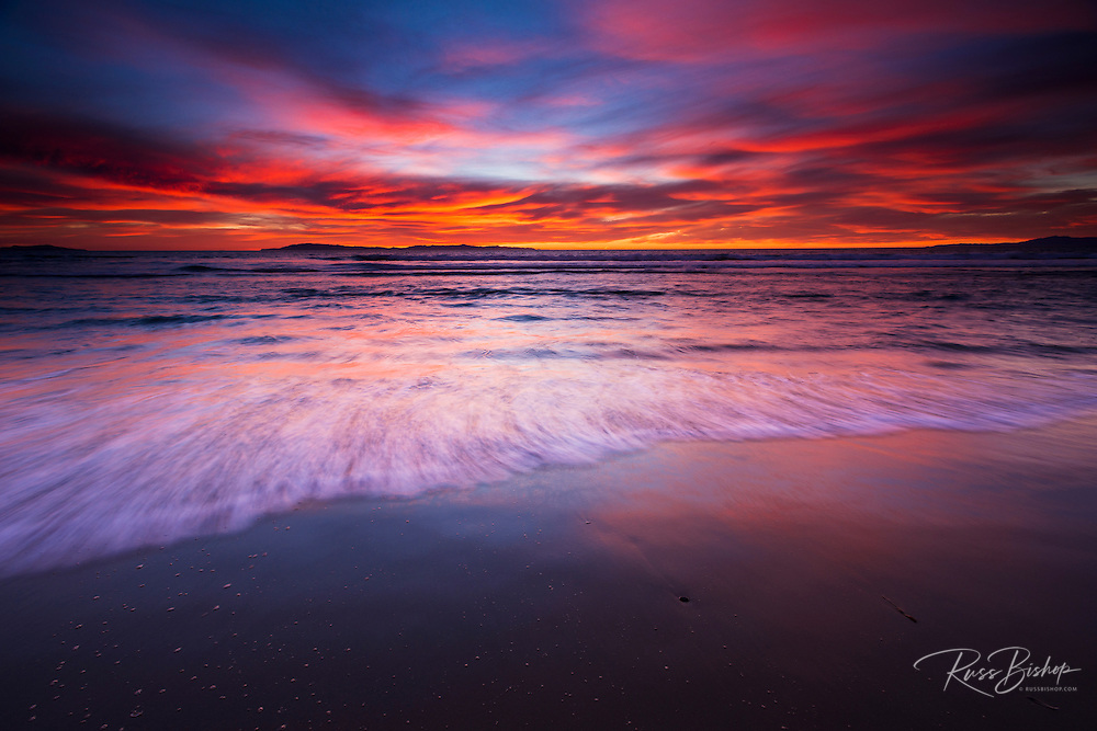 Sunset over the Channel Islands from San Buenaventura State Beach, Ventura, California USA