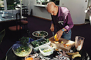 Biosphere 2 Project undertaken by Space Biosphere Ventures, a private ecological research firm funded by Edward P. Bass of Texas.  Roy Walford, former pathologist at UCLA and one of the eight inhabitants of the Biosphere, seen inside Biosphere 2 making mango chutney for lunch. Walford authored a book titled The Anti-Aging Plan. He died in 2004 at age 79 of ALS. Walford had been involved in the Project since 1983, and set up the Biosphere's medical centre.  Biosphere 2 was a privately funded experiment, designed to investigate the way in which humans interact with a small self-sufficient ecological environment, and to look at possibilities for future planetary colonization.  MODEL RELEASED 1992