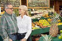 Happy couple standing in farmer's market