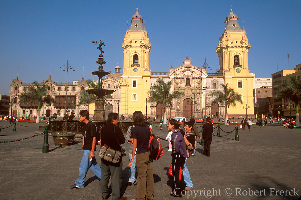 PERU, LIMA, COLONIAL ARCHITECTURE students gathering in the Plaza de Armas  with the Cathedral and the Archbishop's  Palace beyond