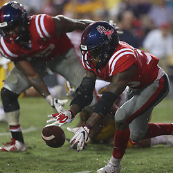 Sep 29, 2018; Baton Rouge, LA, USA; Mississippi Rebels defensive back Zedrick Woods (36) recovers a fumble against the LSU Tigers during the second half of a game at Tiger Stadium. Mandatory Credit: Derick E. Hingle-USA TODAY Sports