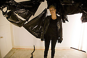 ARTIST OLYMPIA SCARRY IN FRONT OF HER WORK. Come and Check My Gaff. Mixed exhibition in an empty house in Chelsea. I Petyt Place. London. 16 December 2008. Exhibition on until 21 December.  *** Local Caption *** -DO NOT ARCHIVE-© Copyright Photograph by Dafydd Jones. 248 Clapham Rd. London SW9 0PZ. Tel 0207 820 0771. www.dafjones.com.<br /> ARTIST OLYMPIA SCARRY IN FRONT OF HER WORK. Come and Check My Gaff. Mixed exhibition in an empty house in Chelsea. I Petyt Place. London. 16 December 2008. Exhibition on until 21 December.