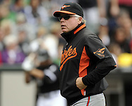 CHICAGO - MAY 01:  Manager Buck Showalter #26 of the Baltimore Orioles looks on during a pitching change against the Chicago White Sox on May 01, 2011 at U.S. Cellular Field in Chicago, Illinois.  The Orioles defeated the White Sox 6-4.  (Photo by Ron Vesely)  Subject:   Buck Showalter