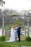 Annapolis, Maryland - April 18, 2015: Hannah North leads the exchanging of vows  for her lifelong friend Stephanie Shearer Cate and her groom Winston Bao Lord at the home of Jeff and Marry Zients' in Annapolis, Maryland Saturday April 18, 2015. <br /> <br /> <br /> <br /> CREDIT: Matt Roth for The New York Times<br /> Assignment ID: 30173318A