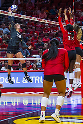 BLOOMINGTON, IL - September 14: McKenna Melville strikes towards Emmy Ogogor during a college Women's volleyball match between the ISU Redbirds and the University of Central Florida (UCF) Knights on September 14 2019 at Illinois State University in Normal, IL. (Photo by Alan Look)